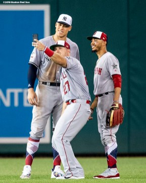WASHINGTON, DC - JULY 17: Aaron Judge #99 of the New York Yankees, Mike Trout #27 of the Los Angeles Angels of Anaheim, and Mookie Betts #50 of the Boston Red Sox pose for a selfie photograph in the outfield during the fourth inning of the 89th MLB All-Star Game at Nationals Park Tuesday, July 17, 2018 in Washington, DC. (Photo by Billie Weiss/Boston Red Sox/Getty Images) *** Local Caption *** Aaron Judge; Mike Trout; Mookie Betts