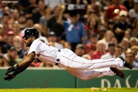 BOSTON, MA - AUGUST 2: Jackie Bradley Jr. #19 of the Boston Red Sox dives into home plate as he scores after getting caught in a run down during the fourth inning of a game against the New York Yankees on August 2, 2018 at Fenway Park in Boston, Massachusetts. (Photo by Billie Weiss/Boston Red Sox/Getty Images) *** Local Caption *** Jackie Bradley Jr.