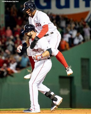 BOSTON, MA - SEPTEMBER 9: Mitch Moreland #18 of the Boston Red Sox is congratulated by Xander Bogaerts #2 after hitting a game winning walk-off RBI single during the ninth inning of a game against the Houston Astros on September 9, 2018 at Fenway Park in Boston, Massachusetts. (Photo by Billie Weiss/Boston Red Sox/Getty Images) *** Local Caption *** Mitch Moreland; Xander Bogaerts