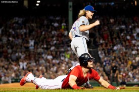 BOSTON, MA - SEPTEMBER 14: Noah Syndergaard #34 of the New York Mets reacts after tagging out Andrew Benintendi #16 of the Boston Red Sox at first base during the third inning of a game on September 14, 2018 at Fenway Park in Boston, Massachusetts. (Photo by Billie Weiss/Boston Red Sox/Getty Images) *** Local Caption *** Noah Syndergaard; Andrew Benintendi
