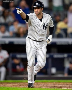 NEW YORK, NY - SEPTEMBER 18: Neil Walker #14 of the New York Yankees reacts after hitting a go ahead three run home run during the seventh inning of a game against the Boston Red Sox on September 18, 2018 at Yankee Stadium in the Bronx borough of New York City. (Photo by Billie Weiss/Boston Red Sox/Getty Images) *** Local Caption *** Neil Walker