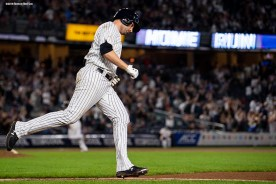 NEW YORK, NY - SEPTEMBER 18: Neil Walker #14 of the New York Yankees rounds the bases after hitting a go ahead three run home run during the seventh inning of a game against the Boston Red Sox on September 18, 2018 at Yankee Stadium in the Bronx borough of New York City. (Photo by Billie Weiss/Boston Red Sox/Getty Images) *** Local Caption *** Neil Walker