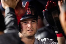 NEW YORK, NY - OCTOBER 8: Andrew Benintendi #16 of the Boston Red Sox high fives teammates after scoring during the fourth inning of game three of the American League Division Series against the New York Yankees on October 8, 2018 at Yankee Stadium in the Bronx borough of New York City. (Photo by Billie Weiss/Boston Red Sox/Getty Images) *** Local Caption *** Andrew Benintendi