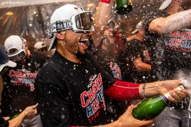 NEW YORK, NY - OCTOBER 9: Mookie Betts #50 of the Boston Red Sox celebrates with champagne in the clubhouse after clinching the American League Division Series in game four against the New York Yankees on October 9, 2018 at Yankee Stadium in the Bronx borough of New York City. (Photo by Billie Weiss/Boston Red Sox/Getty Images) *** Local Caption *** Mookie Betts