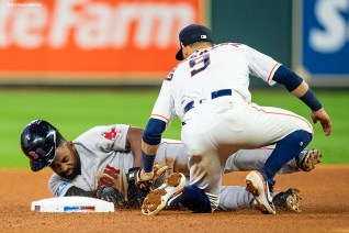 HOUSTON, TX - OCTOBER 17: Marwin Gonzalez #9 of the Houston Astros tags out Jackie Bradley Jr. #19 of the Boston Red Sox on an attempted steal of second base in the fourth inning during Game 4 of the ALCS at Minute Maid Park on Wednesday, October 17, 2018 in Houston, Texas.(Photo by Billie Weiss/Boston Red Sox/Getty Images) *** Local Caption *** Marwin Gonzalez; Jackie Bradley Jr.