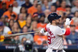HOUSTON, TX - OCTOBER 18: J.D. Martinez #28 of the Boston Red Sox hits a solo home run during the third inning of game five of the American League Championship Series against the Houston Astros on October 18, 2018 at Minute Maid Park in Houston, Texas. (Photo by Billie Weiss/Boston Red Sox/Getty Images) *** Local Caption *** J.D. Martinez