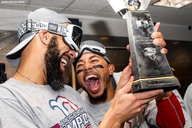 HOUSTON, TX - OCTOBER 18: David Price #24 and Mookie Betts #50 of the Boston Red Sox celebrate with the American League Championship Series trophy in the clubhouse after clinching the American League Championship Series in game five against the Houston Astros on October 18, 2018 at Minute Maid Park in Houston, Texas. (Photo by Billie Weiss/Boston Red Sox/Getty Images) *** Local Caption ***Mookie Betts; David Price