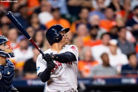 HOUSTON, TX - OCTOBER 18: Rafael Devers #11 of the Boston Red Sox hits a three run home run during the sixth inning of game five of the American League Championship Series against the Houston Astros on October 18, 2018 at Minute Maid Park in Houston, Texas. (Photo by Billie Weiss/Boston Red Sox/Getty Images) *** Local Caption *** Rafael Devers