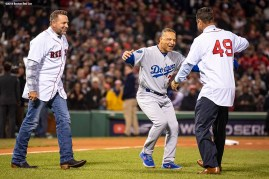 BOSTON, MA - OCTOBER 24: Manager Dave Roberts of the Los Angeles Dodgers reacts with former players Kevin Millar and Tim Wakefield of the Boston Red Sox before throwing out a ceremonial first pitch before game two of the 2018 World Series against the Los Angeles Dodgers on October 23, 2018 at Fenway Park in Boston, Massachusetts. (Photo by Billie Weiss/Boston Red Sox/Getty Images) *** Local Caption *** Kevin Millar; Dave Roberts; Tim Wakefield