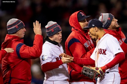 BOSTON, MA - OCTOBER 24: Mookie Betts #50 and Brock Holt #12 of the Boston Red Sox celebrate a victory in game two of the 2018 World Series against the Los Angeles Dodgers on October 23, 2018 at Fenway Park in Boston, Massachusetts. (Photo by Billie Weiss/Boston Red Sox/Getty Images) *** Local Caption *** Mookie Betts; Brock Holt