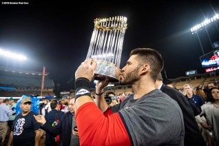 LOS ANGELES, CA - OCTOBER 28: J.D. Martinez #28 of the Boston Red Sox kisses the World Series after winning the 2018 World Series in game five against the Los Angeles Dodgers on October 28, 2018 at Dodger Stadium in Los Angeles, California. (Photo by Billie Weiss/Boston Red Sox/Getty Images) *** Local Caption *** J.D. Martinez