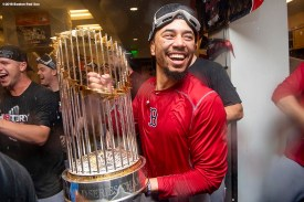 LOS ANGELES, CA - OCTOBER 28: Mookie Betts #50 of the Boston Red Sox celebrates with the World Series trophy after winning the 2018 World Series in game five of the 2018 World Series against the Los Angeles Dodgers on October 28, 2018 at Dodger Stadium in Los Angeles, California. (Photo by Billie Weiss/Boston Red Sox/Getty Images) *** Local Caption *** Mookie Betts