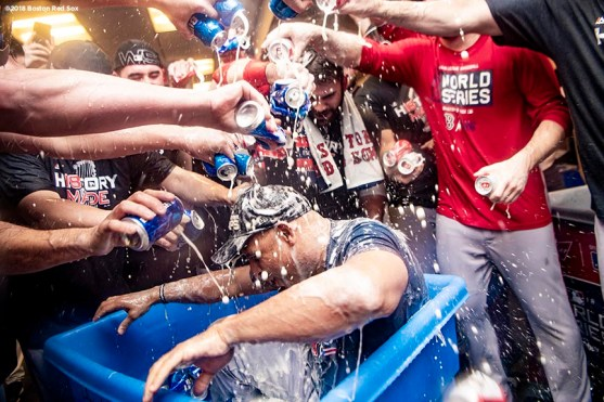 LOS ANGELES, CA - OCTOBER 28: Manager Alex Cora of the Boston Red Sox is dunked in a bucket of beer after winning the 2018 World Series in game five of the 2018 World Series against the Los Angeles Dodgers on October 28, 2018 at Dodger Stadium in Los Angeles, California. (Photo by Billie Weiss/Boston Red Sox/Getty Images) *** Local Caption *** Alex Cora