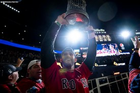 FOXBOROUGH, MA - NOVEMBER 4: J.D. Martinez #28 of the Boston Red Sox hoists the World Series trophy before a game against the Green Bay Packers on November 4, 2018 at Gillette Stadium in Foxborough, Massachusetts. (Photo by Billie Weiss/Boston Red Sox/Getty Images) *** Local Caption *** J.D. Martinez