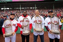 BOSTON, MA - APRIL 9: Steve Pearce #25, former designated hitter David Ortiz, former first baseman Mike Lowell, and former left fielder Manny Ramirez of the Boston Red Sox pose for a photograph with the 2004, 2007, 2013, and 2018 World Series trophies during a 2018 World Series championship ring ceremony before the Opening Day game against the Toronto Blue Jays on April 9, 2019 at Fenway Park in Boston, Massachusetts. All four players won the World Series Most Valuable Player award. (Photo by Billie Weiss/Boston Red Sox/Getty Images) *** Local Caption *** Steve Pearce; David Ortiz; Mike Lowell; Manny Ramirez