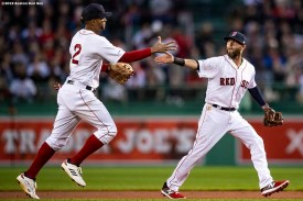 BOSTON, MA - APRIL 11: Dustin Pedroia #15 high fives Xander Bogaerts #2 of the Boston Red Sox after turning a double play during the first inning of a game against the Toronto Blue Jays on April 11, 2019 at Fenway Park in Boston, Massachusetts. (Photo by Billie Weiss/Boston Red Sox/Getty Images) *** Local Caption *** Xander Bogaerts; Dustin Pedroia