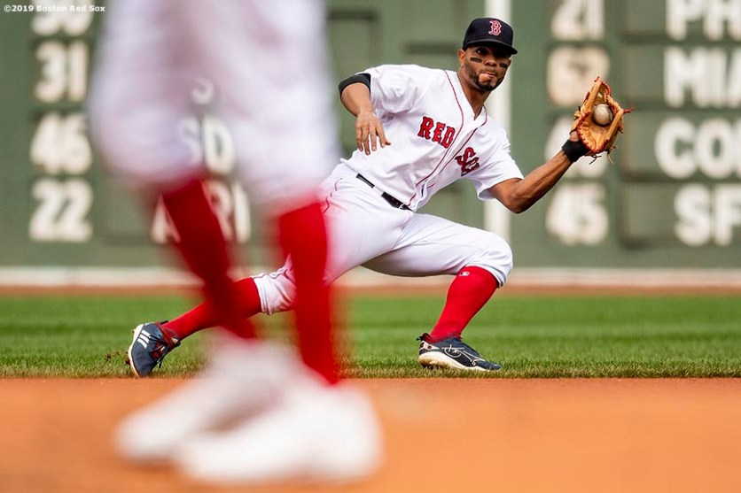 BOSTON, MA - APRIL 14: Xander Bogaerts #2 of the Boston Red Sox fields a ground ball during the first inning of a game against the Baltimore Orioles on April 14, 2019 at Fenway Park in Boston, Massachusetts. (Photo by Billie Weiss/Boston Red Sox/Getty Images) *** Local Caption *** Xander Bogaerts