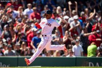 BOSTON, MA - MAY 11: Rafael Devers #11 of the Boston Red Sox scores during the third inning of a game against the Seattle Mariners on May 11, 2019 at Fenway Park in Boston, Massachusetts. (Photo by Billie Weiss/Boston Red Sox/Getty Images) *** Local Caption *** Rafael Devers