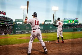 BOSTON, MA - MAY 18: Andrew Benintendi #16 and Mookie Betts #50 of the Boston Red Sox warm up on deck during the first inning of a game against the Houston Astros on May 18, 2019 at Fenway Park in Boston, Massachusetts. (Photo by Billie Weiss/Boston Red Sox/Getty Images) *** Local Caption *** Andrew Benintendi; Mookie Betts