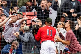 BOSTON, MA - MAY 19: Rafael Devers #11 of the Boston Red Sox attempts to catch a foul ball during the first inning of a game against the Houston Astros on May 19, 2019 at Fenway Park in Boston, Massachusetts. (Photo by Billie Weiss/Boston Red Sox/Getty Images) *** Local Caption *** Rafael Devers
