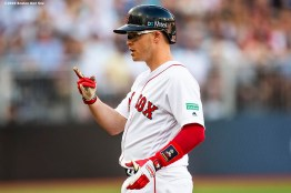 LONDON, ENGLAND - JUNE 29 : Brock Holt #12 of the Boston Red Sox reacts after hitting an RBI single during the first inning of game one of the 2019 Major League Baseball London Series against the New York Yankees on June 29, 2019 at West Ham London Stadium in London, England. (Photo by Billie Weiss/Boston Red Sox/Getty Images) *** Local Caption *** Brock Holt