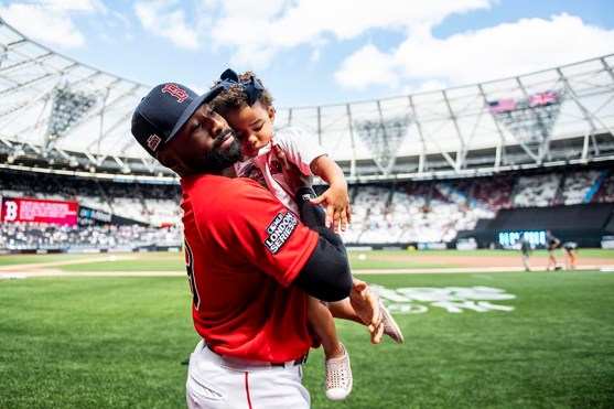 LONDON, ENGLAND - JUNE 30: Jackie Bradley Jr. #19 of the Boston Red Sox kisses his daughter Emerson before game two of the 2019 Major League Baseball London Series against the New York Yankees on June 30, 2019 at West Ham London Stadium in London, England. (Photo by Billie Weiss/Boston Red Sox/Getty Images) *** Local Caption *** Jackie Bradley Jr.
