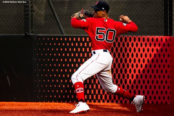 LONDON, ENGLAND - JUNE 30: Mookie Betts #50 of the Boston Red Sox throws the ball during the seventh inning of game two of the 2019 Major League Baseball London Series against the New York Yankees on June 30, 2019 at West Ham London Stadium in London, England. (Photo by Billie Weiss/Boston Red Sox/Getty Images) *** Local Caption *** Mookie Betts