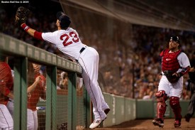 BOSTON, MA - JULY 14: Michael Chavis #23 of the Boston Red Sox lunges into the dugout as he catches a foul ball during the fourth inning of a game against the Los Angeles Dodgers on July 14, 2019 at Fenway Park in Boston, Massachusetts. (Photo by Billie Weiss/Boston Red Sox/Getty Images) *** Local Caption *** Michael Chavis