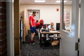 BOSTON, MA - JULY 17: Manager Alex Cora looks at the computer with J.D. Martinez #28 of the Boston Red Sox before a game against the Toronto Blue Jays on July 17, 2019 at Fenway Park in Boston, Massachusetts. (Photo by Billie Weiss/Boston Red Sox/Getty Images) *** Local Caption *** Alex Cora; J.D. Martinez