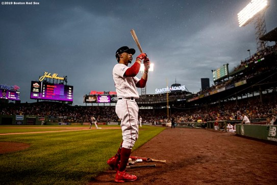BOSTON, MA - JULY 17: Mookie Betts #50 of the Boston Red Sox warms up on deck during the first inning of a game against the Toronto Blue Jays on July 17, 2019 at Fenway Park in Boston, Massachusetts. (Photo by Billie Weiss/Boston Red Sox/Getty Images) *** Local Caption *** Mookie Betts