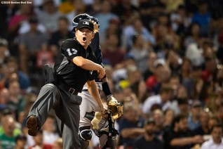 BOSTON, MA - JULY 25: Home plate umpire D.J. Reyburn ejects Brock Holt #12 of the Boston Red Sox from the game after being called out on strikes during the third inning of a game against the New York Yankees on July 25, 2019 at Fenway Park in Boston, Massachusetts. (Photo by Billie Weiss/Boston Red Sox/Getty Images) *** Local Caption *** Brock Holt; D.J. Reyburn
