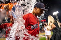 BOSTON, MA - JULY 26: Mookie Betts #50 of the Boston Red Sox is doused with water after hitting three home runs during a game against the New York Yankees on July 26, 2019 at Fenway Park in Boston, Massachusetts. (Photo by Billie Weiss/Boston Red Sox/Getty Images) *** Local Caption *** Mookie Betts