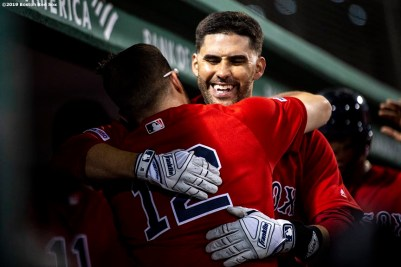 BOSTON, MA - AUGUST 9: J.D. Martinez #28 of the Boston Red Sox hugs Brock Holt #12 after hitting a game tying two run home run during the fourth inning of a game against the Los Angeles Angels of Anaheim on August 9, 2019 at Fenway Park in Boston, Massachusetts. (Photo by Billie Weiss/Boston Red Sox/Getty Images) *** Local Caption *** J.D. Martinez; Brock Holt