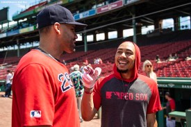 BOSTON, MA - AUGUST 10: Mookie Betts #50 talks with J.D. Martinez #28 of the Boston Red Sox before a game against the Los Angeles Angels of Anaheim on August 10, 2019 at Fenway Park in Boston, Massachusetts. (Photo by Billie Weiss/Boston Red Sox/Getty Images) *** Local Caption *** Mookie Betts; J.D. Martinez
