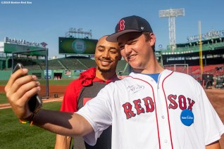 BOSTON, MA - AUGUST 16: Mookie Betts #50 of the Boston Red Sox poses for a selfie photograph with Make-A-Wish participant Lucas before a game against the Baltimore Orioles on August 16, 2019 at Fenway Park in Boston, Massachusetts. (Photo by Billie Weiss/Boston Red Sox/Getty Images) *** Local Caption *** Mookie Betts