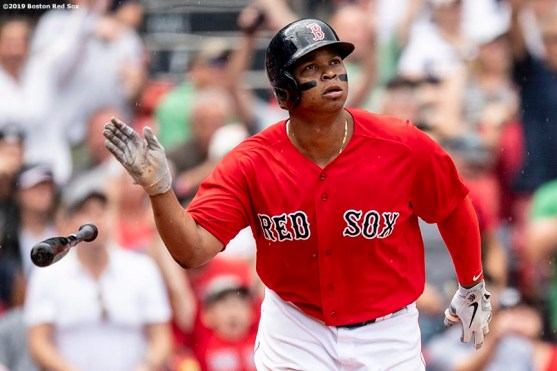 BOSTON, MA - AUGUST 18: Rafael Devers #11 of the Boston Red Sox tosses his bat after hitting a two run home run to record his 100th and 101st RBI of the season during the seventh inning of a game against the Baltimore Orioles on August 18, 2019 at Fenway Park in Boston, Massachusetts. (Photo by Billie Weiss/Boston Red Sox/Getty Images) *** Local Caption *** Rafael Devers