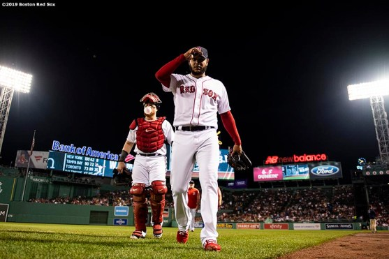 BOSTON, MA - SEPTEMBER 4: Christian Vazquez #7 and Eduardo Rodriguez #57 of the Boston Red Sox walk toward the dugout before a game against the Minnesota Twins on September 4, 2019 at Fenway Park in Boston, Massachusetts. (Photo by Billie Weiss/Boston Red Sox/Getty Images) *** Local Caption *** Christian Vazquez; Eduardo Rodriguez