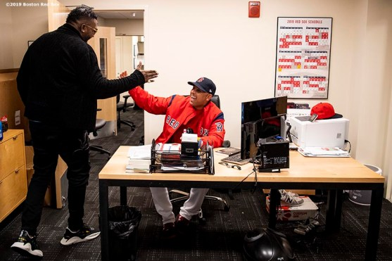 BOSTON, MA - SEPTEMBER 9: Former designated hitter David Ortiz #34 of the Boston Red Sox greets manager Alex Cora in his office before throwing out a ceremonial first pitch as he returns to Fenway Park before a game against the New York Yankees on September 9, 2019 at Fenway Park in Boston, Massachusetts. (Photo by Billie Weiss/Boston Red Sox/Getty Images) *** Local Caption *** David Ortiz; Alex Cora