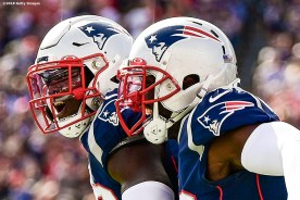 FOXBOROUGH, MA - SEPTEMBER 22: Devin McCourty #32 of the New England Patriots reacts with Jason McCourty #30 after intercepting a pass during the third quarter of a game against the New York Jets at Gillette Stadium on September 22, 2019 in Foxborough, Massachusetts. (Photo by Billie Weiss/Getty Images) *** Local Caption *** Devin McCourty; Jason McCourty;