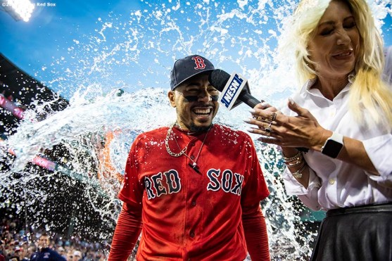 BOSTON, MA - SEPTEMBER 29: Mookie Betts #50 of the Boston Red Sox is doused by Gatorade after scoring the game winning run on a walk-off single hit by Rafael Devers #11 during the ninth inning of a game against the Baltimore Orioles on September 29, 2019 at Fenway Park in Boston, Massachusetts. (Photo by Billie Weiss/Boston Red Sox/Getty Images) *** Local Caption *** Mookie Betts