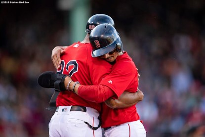 BOSTON, MA - SEPTEMBER 29: Mookie Betts #50 of the Boston Red Sox hugs first base coach Tom Goodwin after hitting an RBI single during the third inning of a game against the Baltimore Orioles on September 29, 2019 at Fenway Park in Boston, Massachusetts. (Photo by Billie Weiss/Boston Red Sox/Getty Images) *** Local Caption *** Mookie Betts; Tom Goodwin