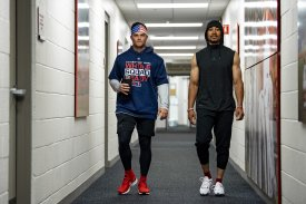 FT. MYERS, FL - MARCH 7: Andrew Benintendi #16 and Mookie Betts #50 of the Boston Red Sox walk through the hallway before a game against the Minnesota Twins on March 7, 2019 at JetBlue Park at Fenway South in Fort Myers, Florida. (Photo by Billie Weiss/Boston Red Sox/Getty Images) *** Local Caption *** Andrew Benintendi; Mookie Betts