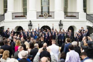 WASHINGTON, DC - MAY 9: U.S. President Donald Trump poses for a photograph with members of the Boston Red Sox during a visit to the White House in recognition of the 2018 World Series championship on May 9, 2019 in Washington, DC. (Photo by Billie Weiss/Boston Red Sox/Getty Images) *** Local Caption *** Donald Trump