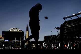 FOXBOROUGH, MA - DECEMBER 29: A member of the Miami Dolphins looks on before a game against the New England Patriots at Gillette Stadium on December 29, 2019 in Foxborough, Massachusetts. (Photo by Billie Weiss/Getty Images) *** Local Caption ***