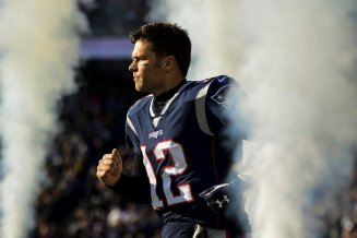 FOXBOROUGH, MA - DECEMBER 29: Tom Brady #12 of the New England Patriots runs onto the field before a game against the Miami Dolphins at Gillette Stadium on December 29, 2019 in Foxborough, Massachusetts. (Photo by Billie Weiss/Getty Images) *** Local Caption *** Tom Brady