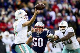 FOXBOROUGH, MA - DECEMBER 29: Chase Winovich #50 of the New England Patriots applies pressure on Ryan Fitzpatrick #14 of the Miami Dolphins during the second quarter of a game at Gillette Stadium on December 29, 2019 in Foxborough, Massachusetts. (Photo by Billie Weiss/Getty Images) *** Local Caption *** Chase Winovich; Ryan Fitzpatrick