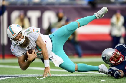 FOXBOROUGH, MA - DECEMBER 29: Ryan Fitzpatrick #14 of the Miami Dolphins carries the ball for a touchdown during the third quarter of a game against the New England Patriots at Gillette Stadium on December 29, 2019 in Foxborough, Massachusetts. (Photo by Billie Weiss/Getty Images) *** Local Caption *** Ryan Fitzpatrick