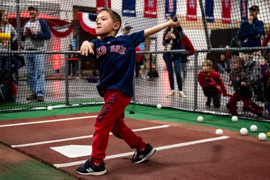 SPRINGFIELD, MA - JANUARY 18: A young fan takes swings at the fan fest during the 2020 Red Sox Winter Weekend on January 18, 2020 at MGM Springfield and MassMutual Center in Springfield, Massachusetts. (Photo by Billie Weiss/Boston Red Sox/Getty Images) *** Local Caption ***