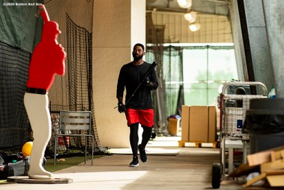 FT. MYERS, FL - FEBRUARY 16: Jackie Bradley Jr. #19 of the Boston Red Sox walks through the batting cage during a team workout on February 16, 2020 at jetBlue Park at Fenway South in Fort Myers, Florida. (Photo by Billie Weiss/Boston Red Sox/Getty Images) *** Local Caption *** Jackie Bradley Jr.