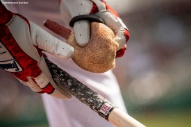 FT. MYERS, FL - FEBRUARY 25: Mitch Moreland #18 of the Boston Red Sox powders his bat during the second inning of a Grapefruit League game against the Baltimore Orioles on February 25, 2020 at jetBlue Park at Fenway South in Fort Myers, Florida. (Photo by Billie Weiss/Boston Red Sox/Getty Images) *** Local Caption *** Mitch Moreland